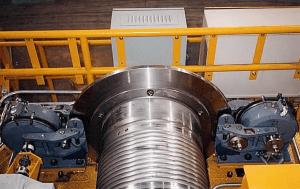 Spring-set, magnetically released emergency-duty caliper brakes